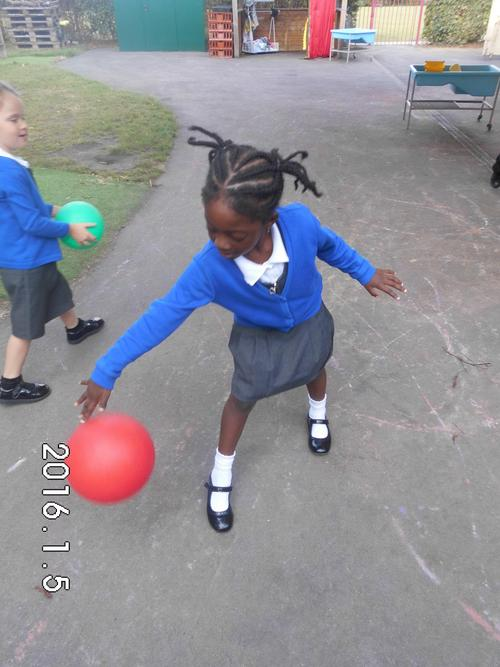 Bouncing a ball using one hand.