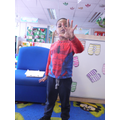 'I'm spiderman, i make webs like this' (shows with his hands)