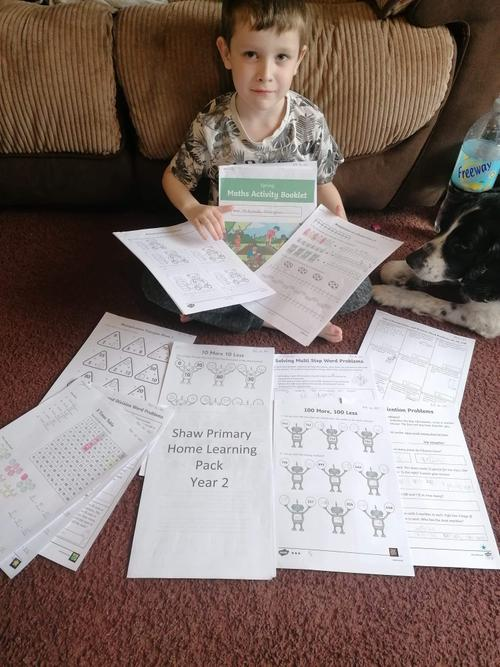 Mitchell has been busy completing his work packs!