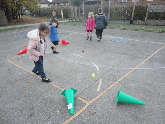 Knocking down the cones with a small ball