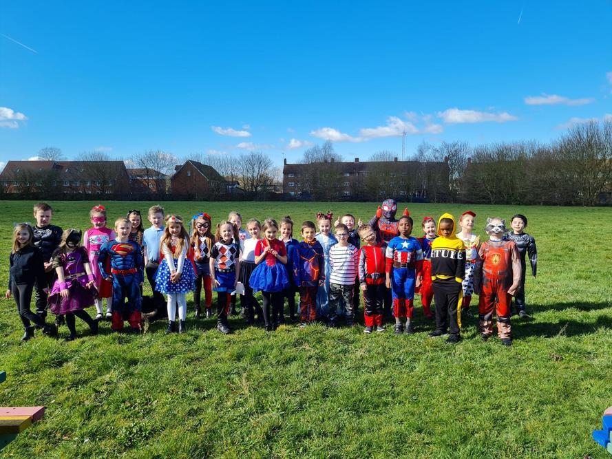 2C dressed as Super Heroes