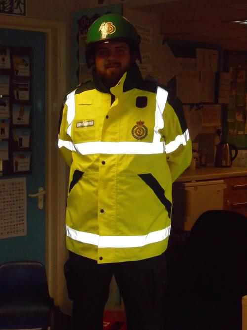 The paramedic coat is yellow with bright stripes