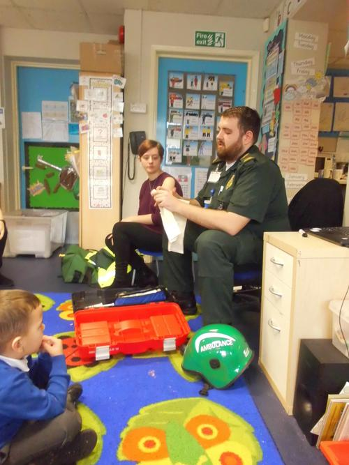 Ross showed the children how to tie a bandage