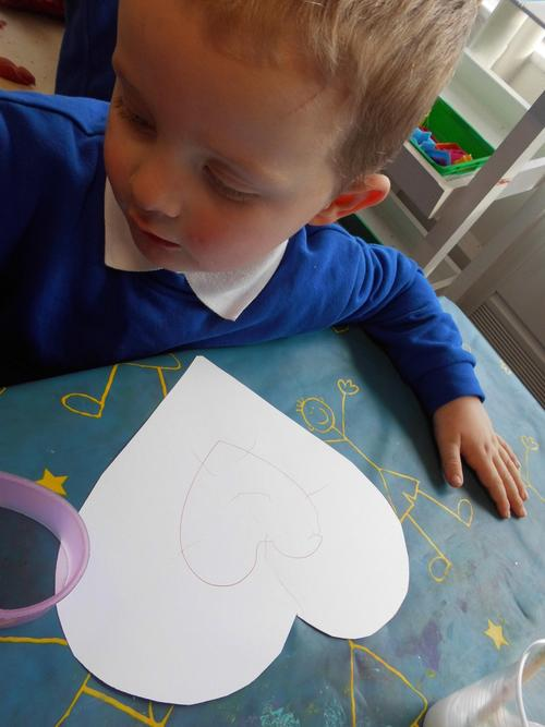 Harry drawing a love heart