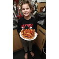 Finley was inspired to make a homemade pizza as he is writing an instruction text!