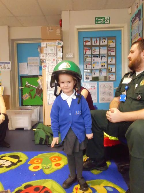 Trying the green helmet on