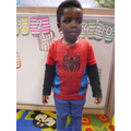 'I'm black spiderman,i shoot someone and catch them' (shows shooting a web with his hands)