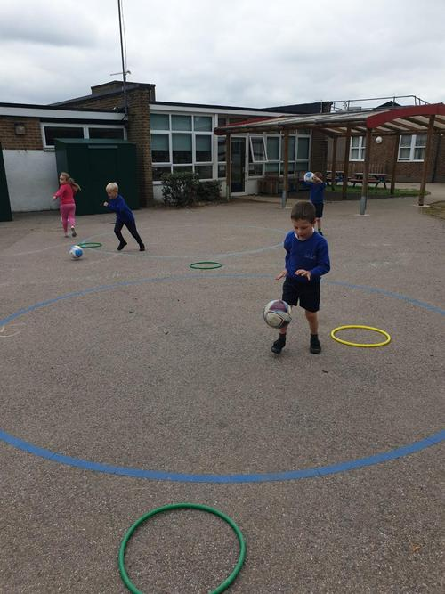 Practicing catching, throwing and dribbling.