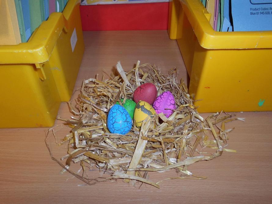 The eggs were pretty colours in a nest.