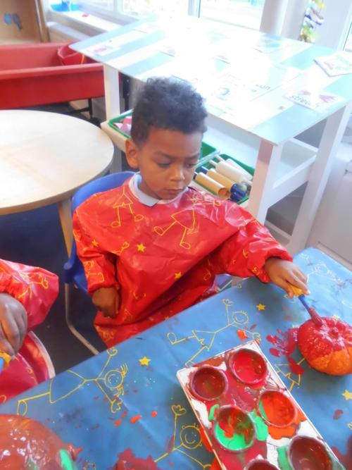 Montell enjoyed using the paints to paint pumpkins