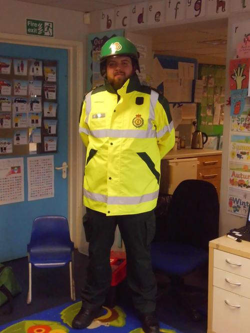 Ross the paramedic wears a yellow coat