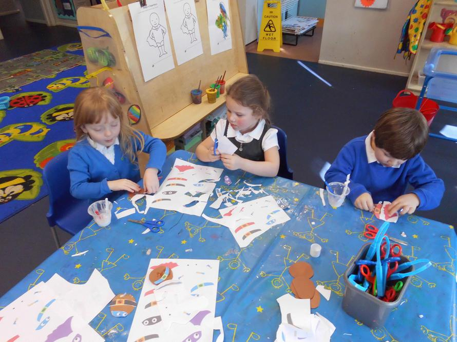 The children cut out shapes to make a Supertato
