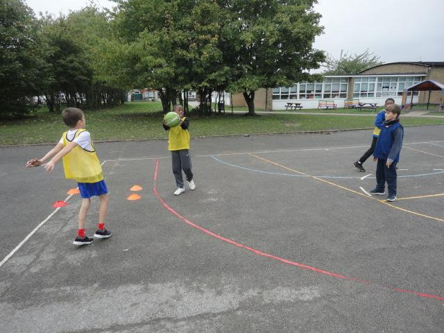 Developing team work in Basketball.