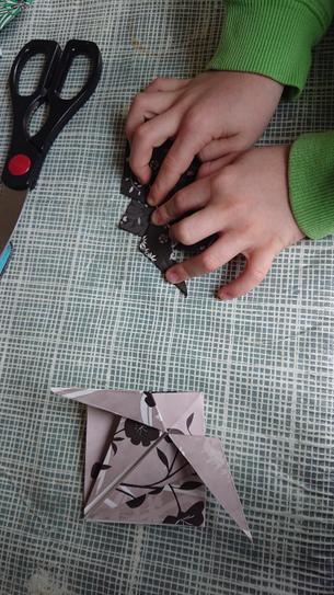 Ryan 4VB  making origami sea creatures.