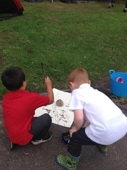 Splattering and painting with sticks