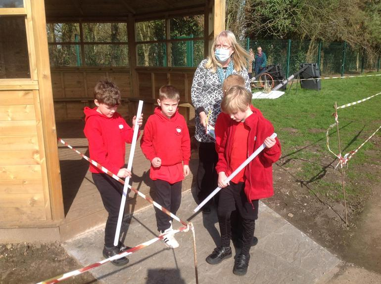 Swaledale children measure areas of the school as part of their survey.