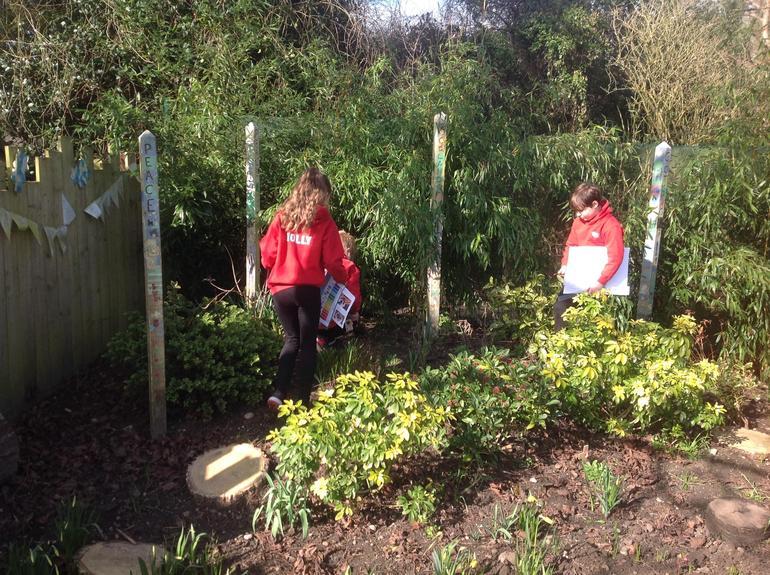Children test the soil moisture and ph levels.