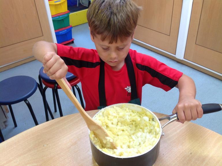 Mashing home grown potatoes