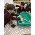 Making boats - how many 1p coins can they hold?
