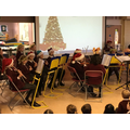 Our orchestra playing Christmas Carols in assembly