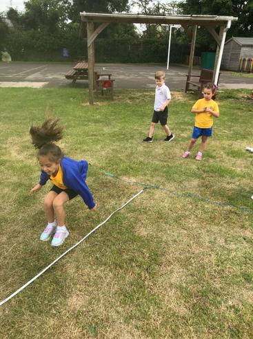 Taya trying her best in the long jump