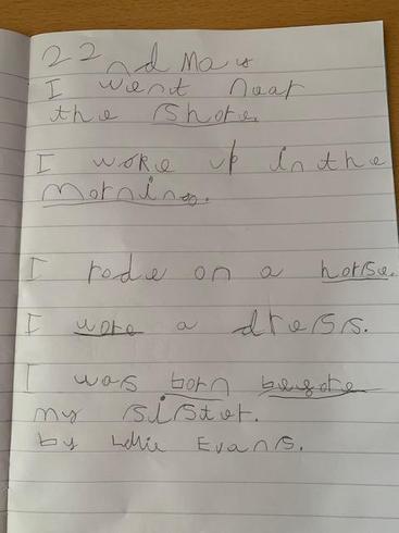 Lillie writing sentences