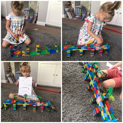 Evalyn constructing her bridge with Lego
