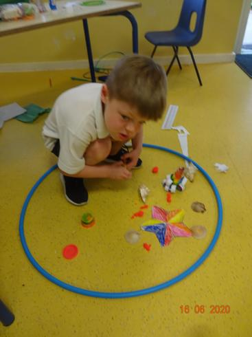 Max using his imagination for his undersea world