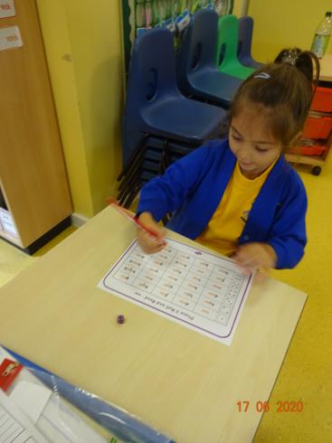 Taya busy with her phonics learning