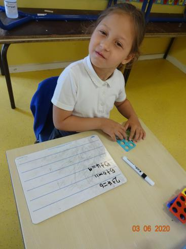 Angie doing maths