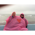 Mrs Irvin and Mrs Henman sporting their fetching 2 person waterproof!
