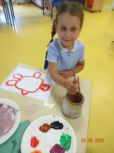 Anabella painting her own turtle design