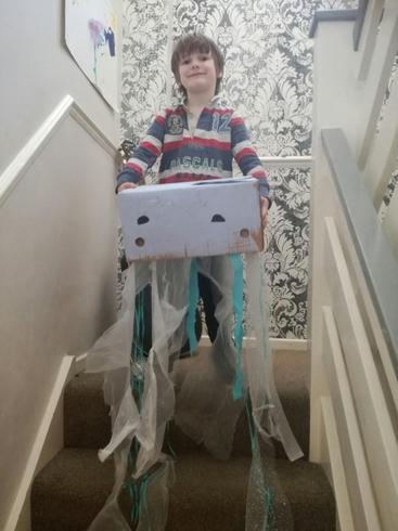 Dexter looking happy with his jellyfish sculpture