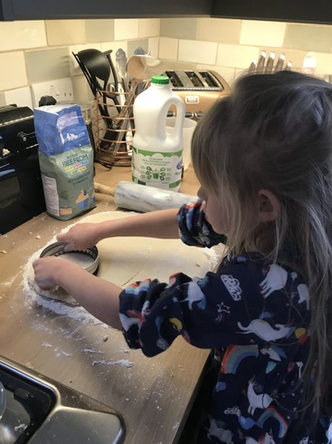 Evalyn busy in the kitchen baking scones