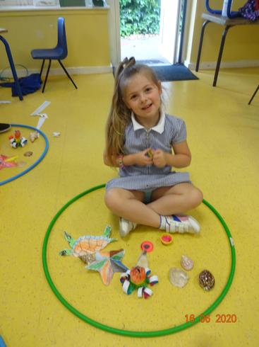 Sienna playing with her undersea creatures