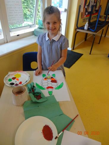 Sienna painting a turtle