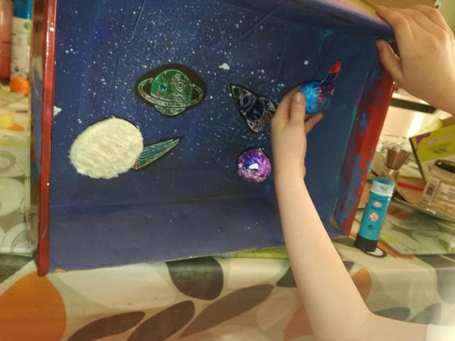 Dexter made a Solar System out of a shoebox
