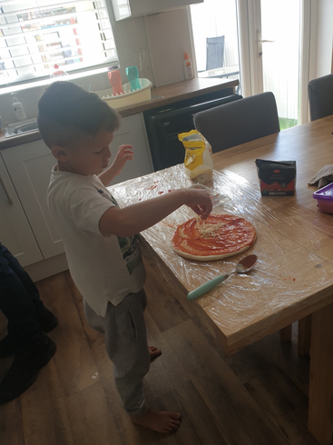 Danny busy making pizza