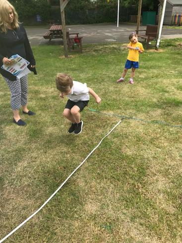 Max doing the long jump