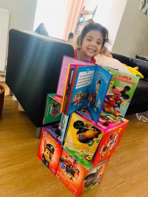 Mina creating a reading tower
