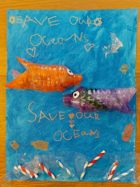 Maia's poster and recycled plastic fish