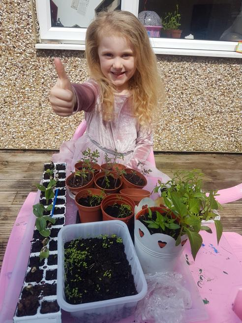 Gabriella planting her own vegetables