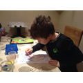 Liam enjoying his art.