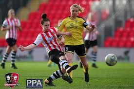 Miss Chubb captaining her team at Exeter City FC.