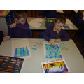 We made a background using pastels.