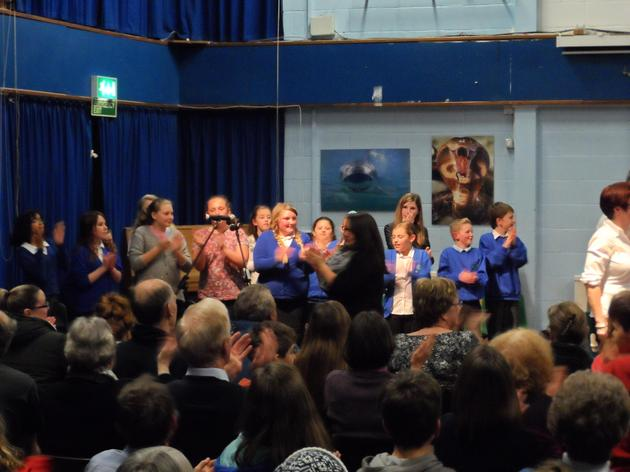 The School Choir singing with Jubilee Brass