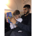 Amaan reading with his uncle