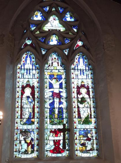 The beautiful stained glass window.