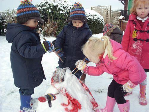 Making a snowman.