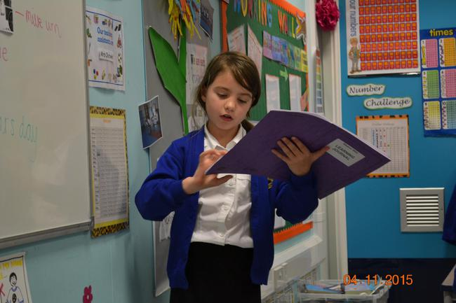 Ellie reading out her story opening to the class.
